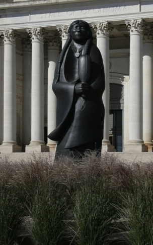A heroic-sized statue by Alan Houser graces the south side of the State Capitol grounds in Oklahoma City.